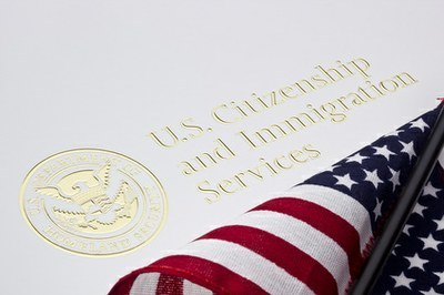 flag, logo and the words US Citizenship and Immigration Services