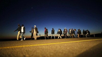 migrants along roadway